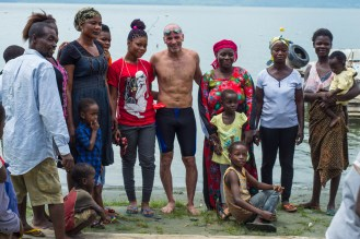 Locals taking pictures with Martin after the swim