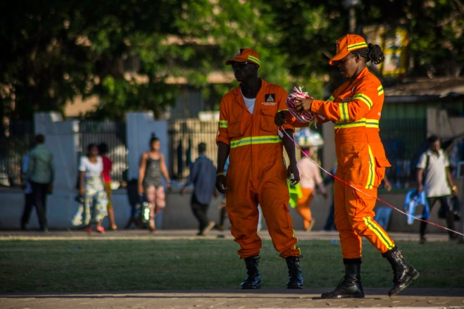 Maintenance workers at the Kwame Nkrumah interchange close for the day. Accra,Ghana.