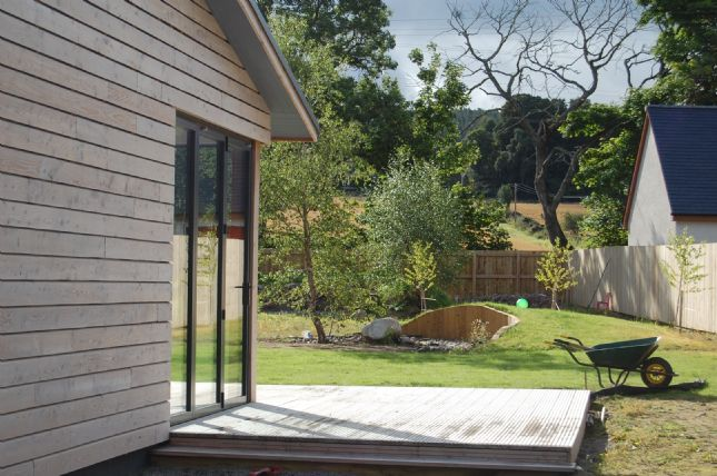 Scottish larch clad house in Inverness-shire