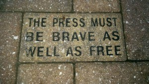 A simple patio tile at Poynter Institute reminds journalists how to respond when we face resistance.
