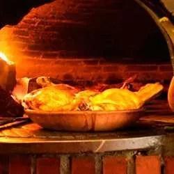 Receta de Lechazo asado en horno de leña