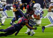 Indianapolis Colts wide receiver Marcus Johnson (83) is tackled by Houston Texans Taiwan Jones (34) and defensive back Keion Crossen (35) during the third quarter of an NFL football game at NRG Stadium on Thursday, Nov. 21, 2019, in Houston.
