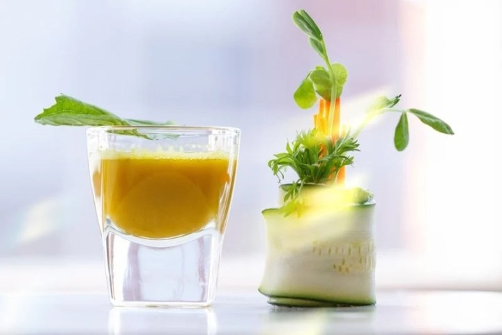 Raw Zucchini Roll-Ups with a turmeric shooter on the side