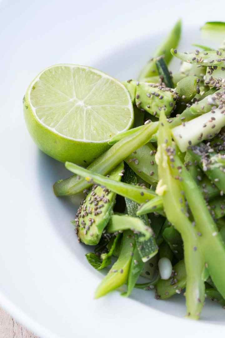 Close up of a vegetable salad and half a juicy lime