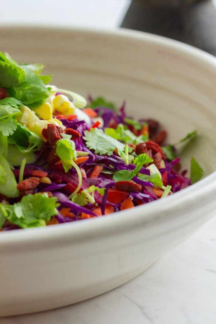 Close up of a freshly grated and shredded raw vegetable salad