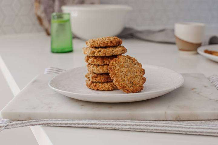 Close up of a stack of healthy ANZAC biscuits on a plate