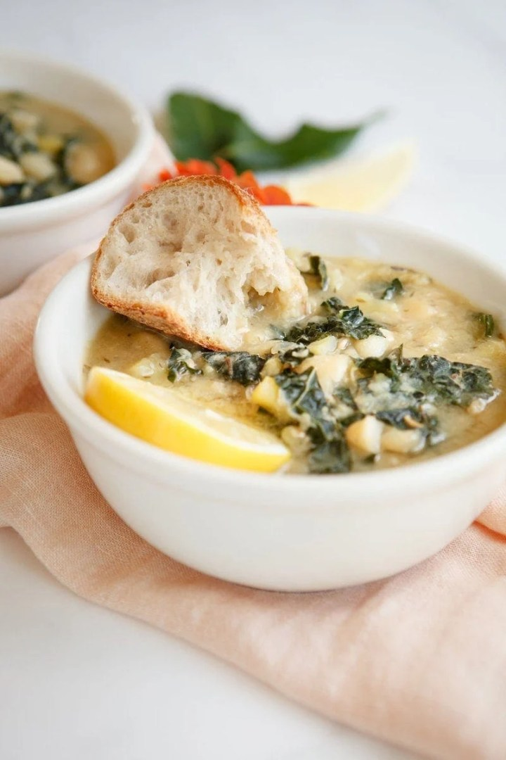 Lemon White Bean Kale Soup with a chunk or rustic bread dipped in