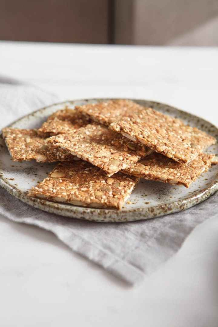 Side profile of Speedy Super Seed Crackers on a ceramic plate