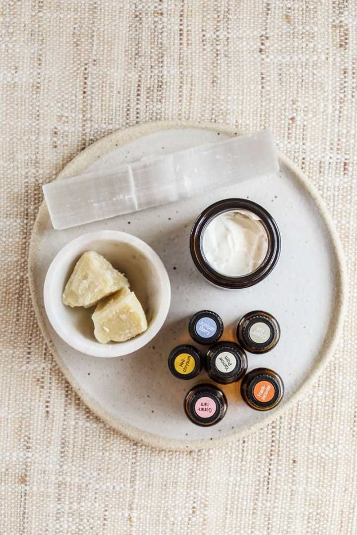 DIY face cream on a ceramic plate with essential oils