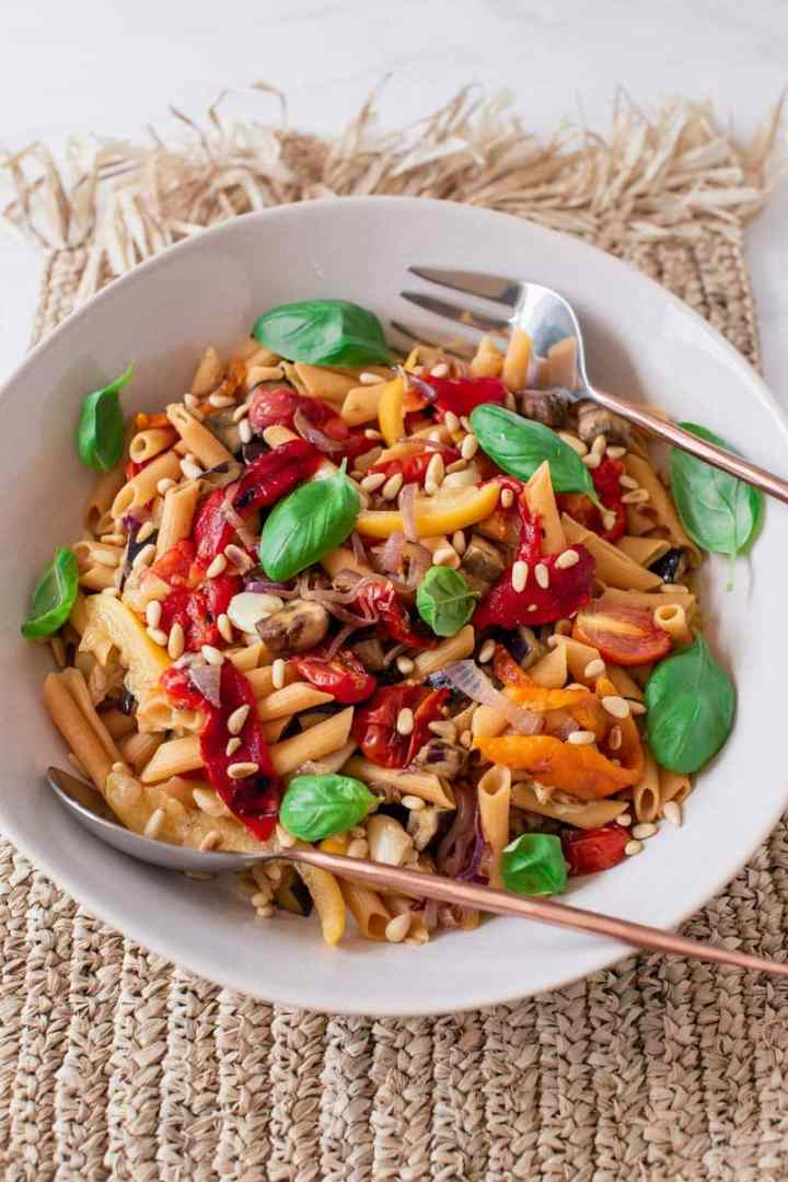 A large vibrant bowl of healthy pasta salad with roasted capsicum, eggplant and preserved lemon