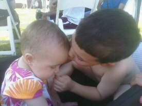 Giving his cousin Ava a kiss