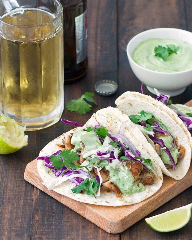 Blackened Fish Tacos On A Wooden Board And Glass Of Beer In The Background