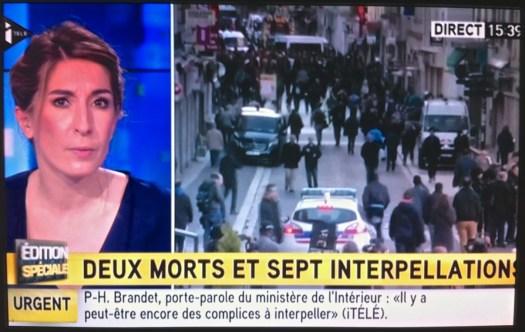Uso justo de un asalto táctico por televisión, 'en vivo'. | Foto capturada de una pantalla de televisión. París Francia. 18/11/2015, 15h39. (iTÉLÉ).