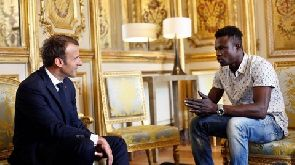 Malian Spiderman rescues Paris child, then meets French president.
