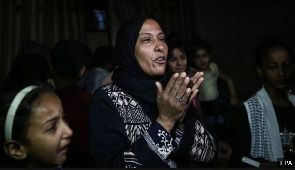 Palestinian relatives mourn during the funeral of eight-month-old Layila al-Ghandour
