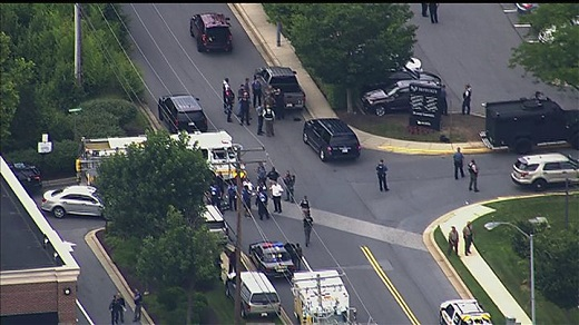 Helicopter video shows police escorting people from the Capital Gazette newspaper building