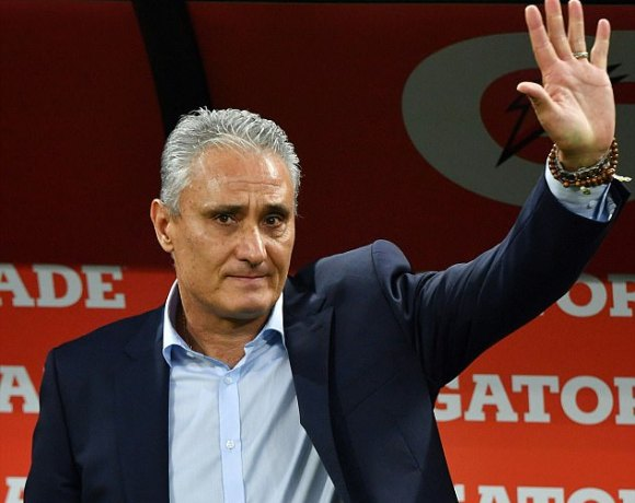 3EB975C700000578-4359774-Brazil_manager_Tite_waves_to_fans_as_his_side_became_the_first_t-m-1_1490794793580