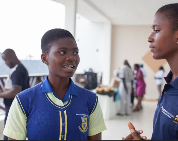 Susanne Twieky (left), a student at Nsein SHS, speaks to Aker-GNPC scholars program 2018 beneficiary student, Sandra Odoom.