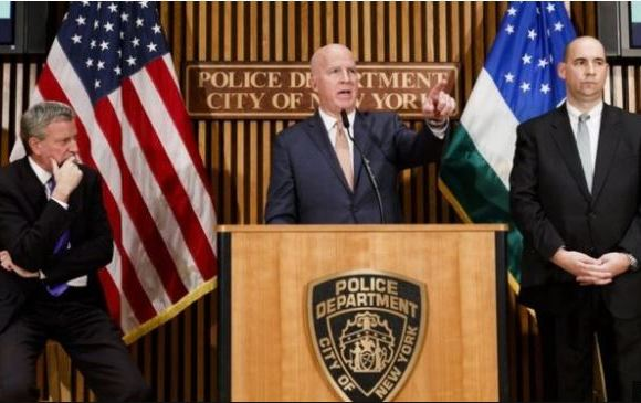 New York Police Commissioner James O'Neill (centre), brief reporters