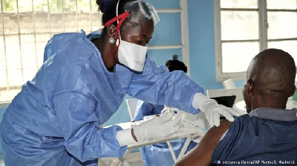 A nurse giving a patient an injection (file photo)