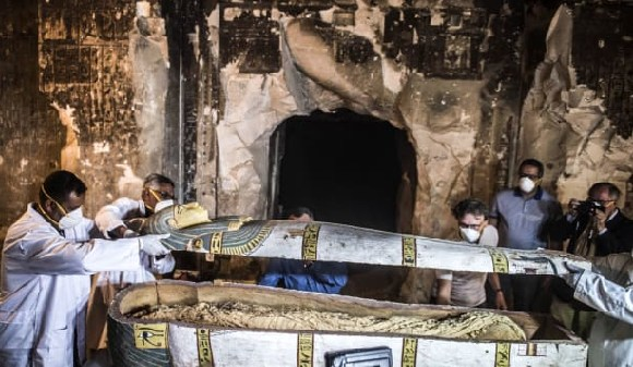 Officials open the sarcophagus in the city of Luxor, southern Egypt.