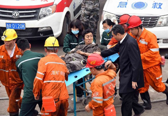 The survivor being rushed to the hospital for treatment (file photo)