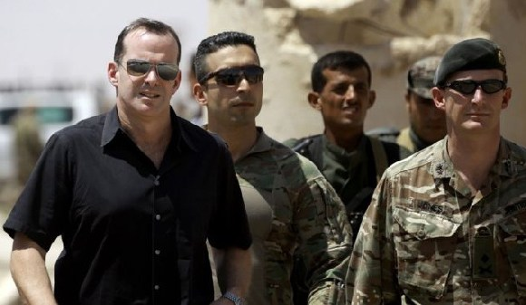 Mr McGurk (L) had previously said the US should retain a presence in Syria