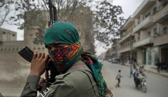 A member of a Kurdish militia patrols in Manbij, in northern Syria, in this photo from 2018