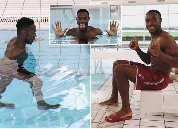 Danny Welbeck rests in pool