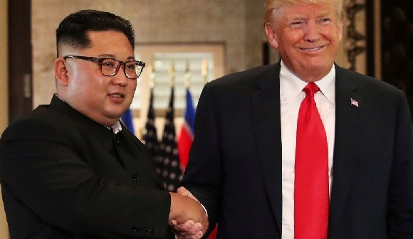 Kim and Trump shake hands after their summit in June in Singapore