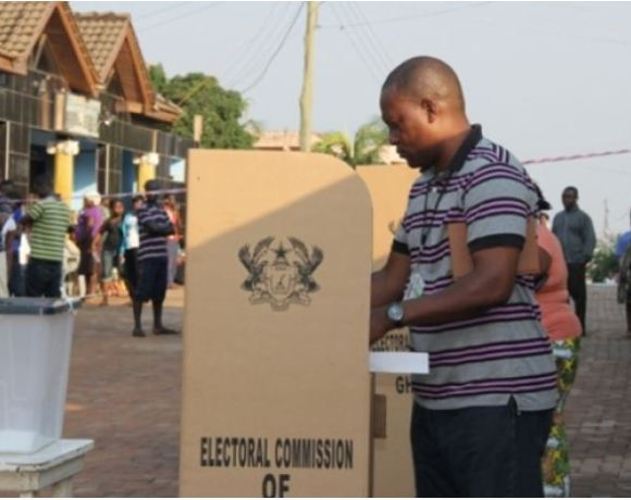 Man casts vote at polling station