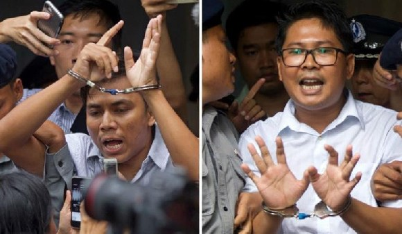 Reuters journalists Kyaw Soe Oo (l) and Wa Lone have spent more than a year behind bars
