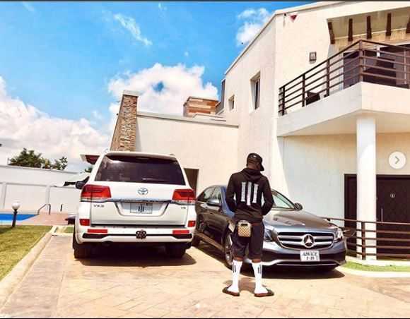 Shatta Wale, one of Zylofon signed artist showcasing his cars and mansion