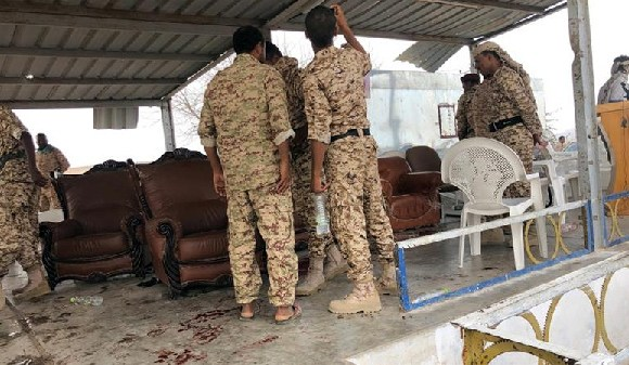 Soldiers inspected the scene of the Houthi drone attack at Yemeni government military parade
