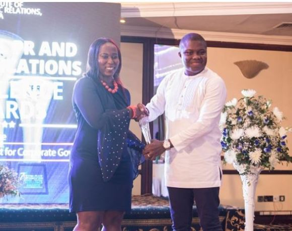 From (R) Corporate Affairs Manager at Vodafone Ghana, Ebenezer Amankwah receiving the award