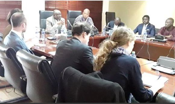 Mr Kwaku Ampratwum Sarpong (5th right) making a point at the meeting with the EU delegation