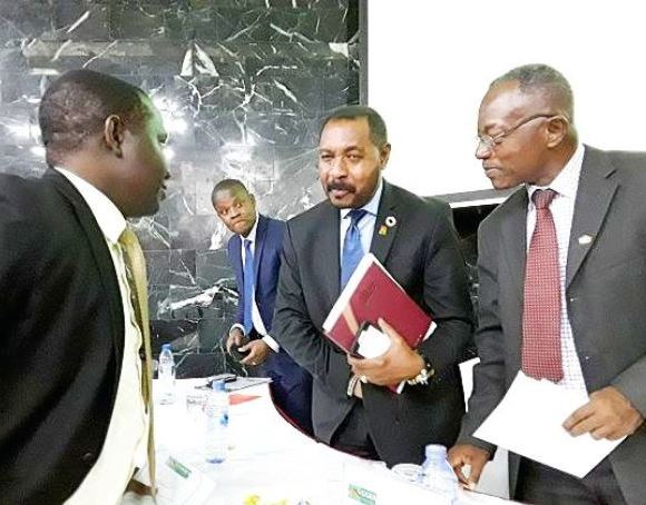 Nana Osei Bonsu (2nd right) interacting with Mr Stephen Antwi (right) and other dignitaries