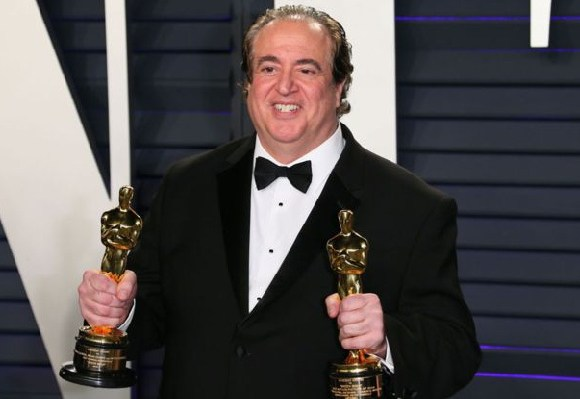 Nick Vallelonga with two of Green Book's Oscars