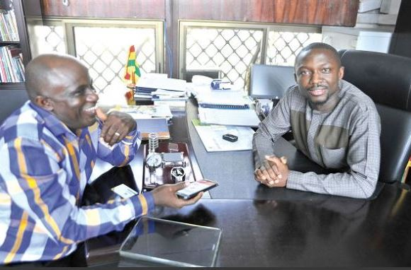 Severious Kale-Dery, the Daily Graphic reporter (left), interviewing Mr Hayford Siaw