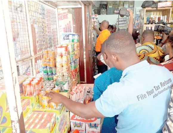 Some officers of the GRA checking tax stamps on some products at Okaishie in Accra