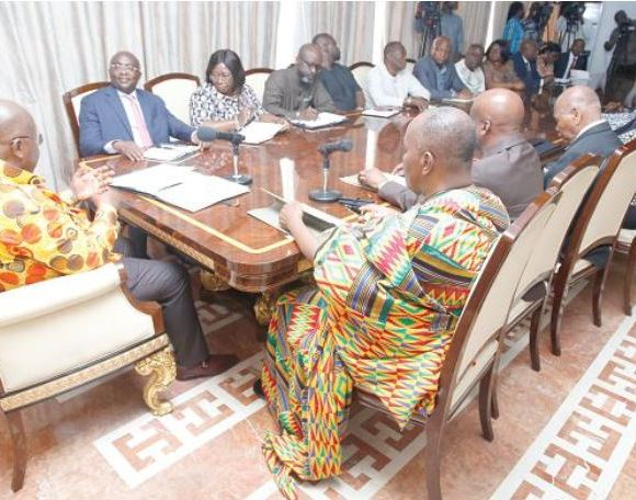 Akufo-Addo (left) speaking at the meeting with members of the Council of State at the Jubilee House