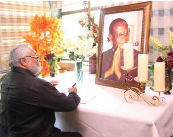 Former President, Jerry John Rawlings signing the book of condolence