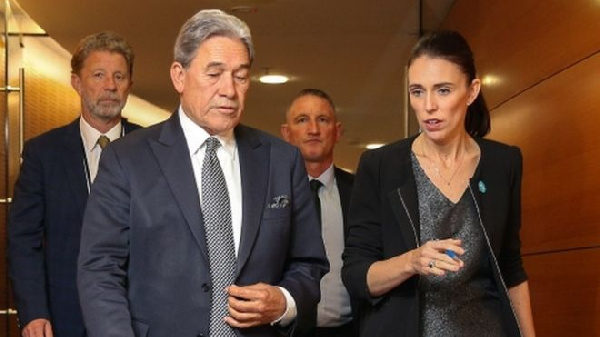 Prime Minister Jacinda Ardern (R) said details of the new gun laws would be outlined within days