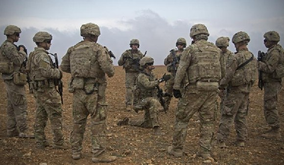 US soldiers gather for a brief during a combined joint patrol rehearsal in Manbij, Syria