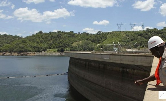 An official of the Zimbabwe Electricity Supply Authourity nspects water levels on the Kariba dam