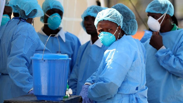 Medical staff wait to treat patients at a cholera centre set up in Beira, Mozambique