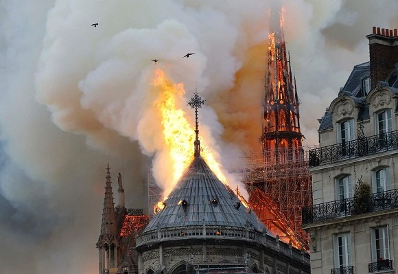 There were gasps from the crowd at the moment Notre-Dame's spire fell