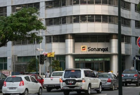 Cars are seen in front of the head office of Angola's state oil company Sonangol in Luanda