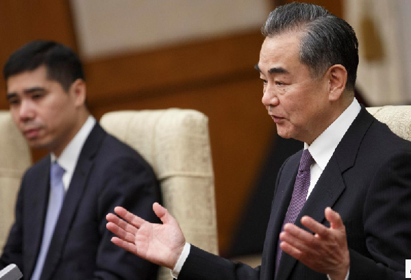 Chinese Foreign Minister Wang Yi (R) meets Iranian Foreign Minister Mohammad Javad Zarif