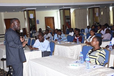 Kwame Baah-Acheamfour addressing participants at the meeting